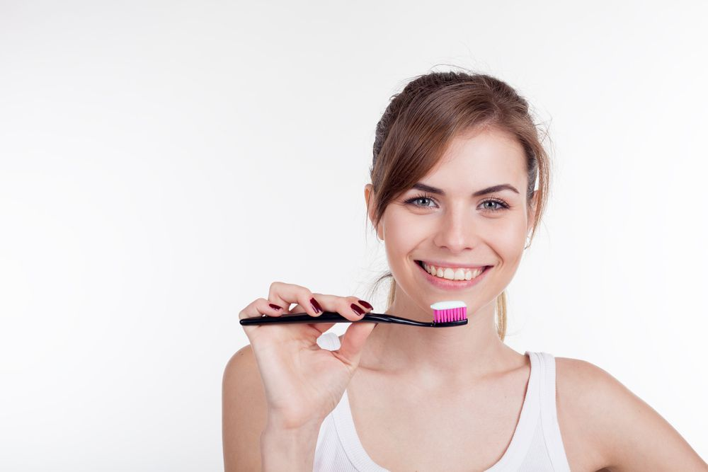 Girl is going to brush your teeth with a toothbrush