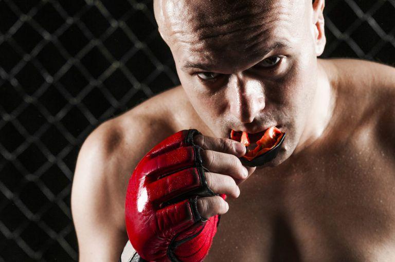 Man wearing rubber sports mouth guard